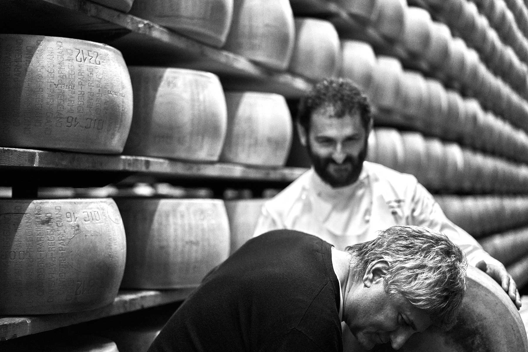 Rocco Princi inspects a wheel of Parmigiano Reggiano cheese